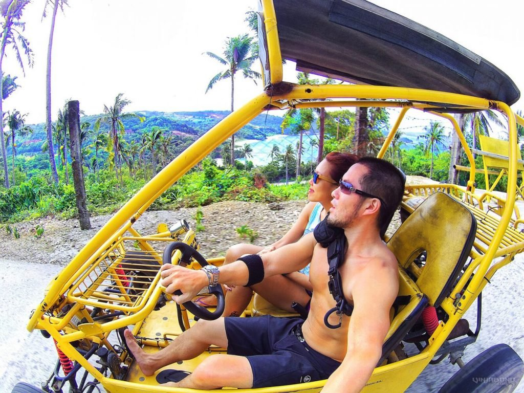 Riding a buggy around Boracay Island, Philippines /// VINJABOND