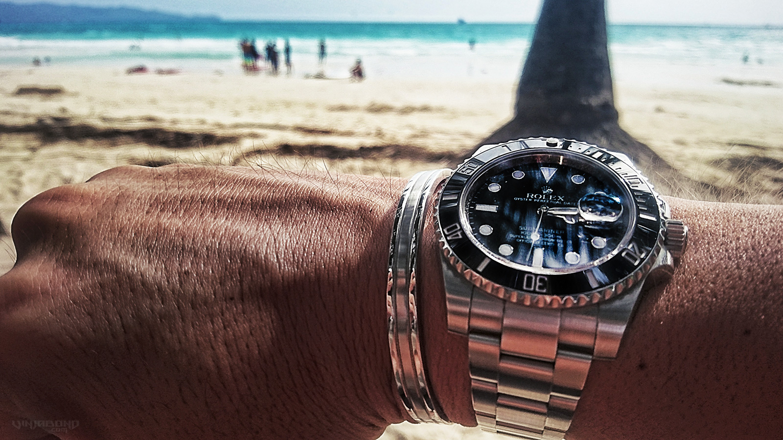 Rolex Submariner at White Beach on Boracay, Philippines /// VINJABOND