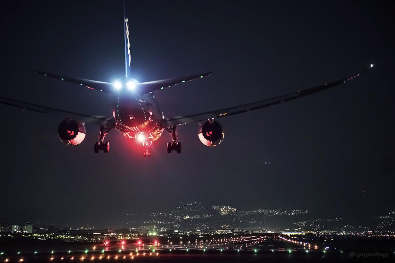 Jets Landing at an Airport at Night /// VINJABOND