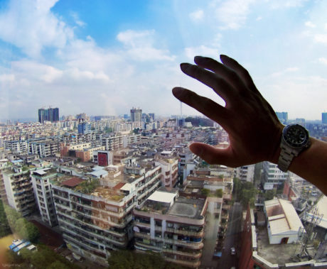 View of the gritty urban jungle of Guangzhou from a derelict safehouse in China /// Vinjatek